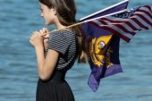 A girl watching Blue Angels